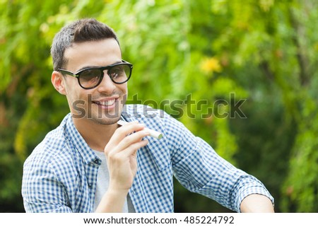 Man smoking an electronic cigarette outdoor