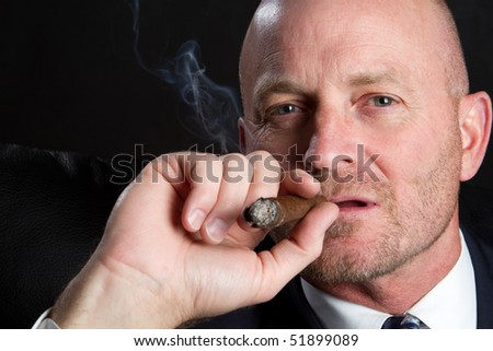Man Smoking Cigar - stock photo