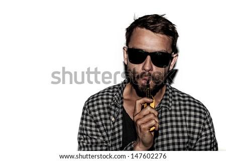 man smoking e-cigarette wearing sunglasses - stock photo