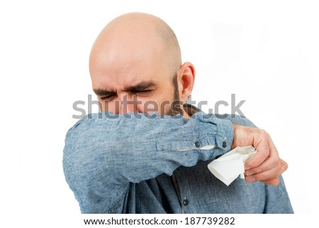 man sneezes, isolated on white  - stock photo