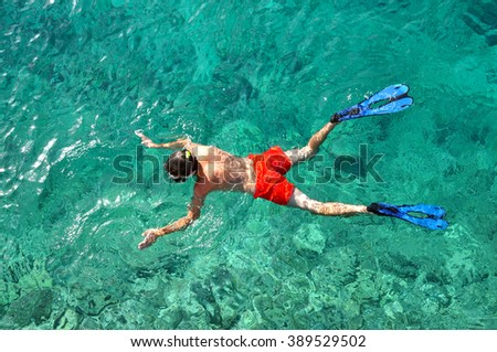 Man snorkeling in a tropical sea - stock photo