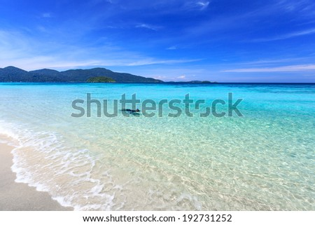 Man snorkeling in crystal clear turquoise water at tropical beach, Koh Lipe, Thailand - stock photo