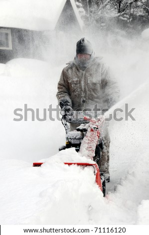 Man snow blowing - stock photo