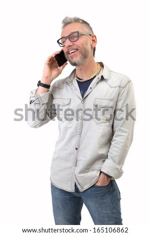 Man speaking at phone and smiling on white background - stock photo