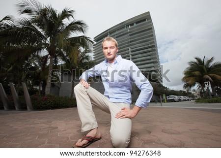 Man squatting on the streets of Miami - stock photo