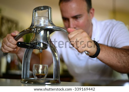 Man squeezing espresso coffee