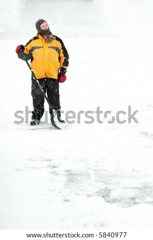Man Standing and thinking about shoveling snow - stock photo