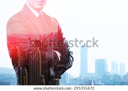man standing and thinking on buildings backgrounds - stock photo