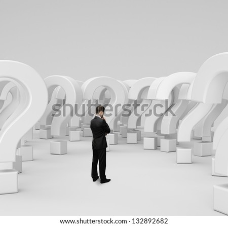 man standing and thinking on many questions - stock photo