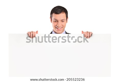 Man standing behind a blank billboard isolated on white background - stock photo