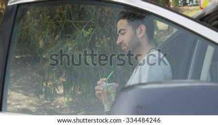Man standing by car waiting for roadside assistance - stock photo