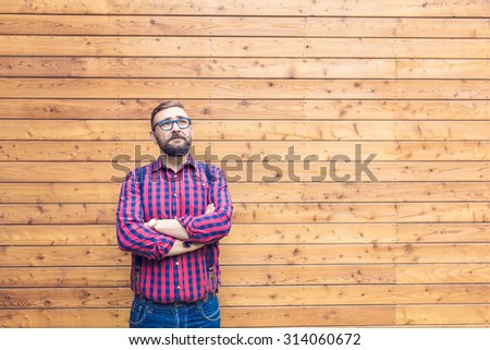 Man standing by the wooden wall - stock photo