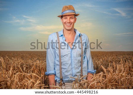 man standing in front of corn field - stock photo