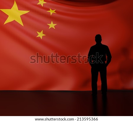 Man standing in front of flag of china; stage presentations - stock photo