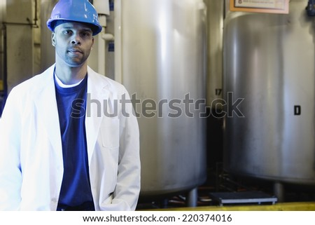 Man standing in front of steel containers