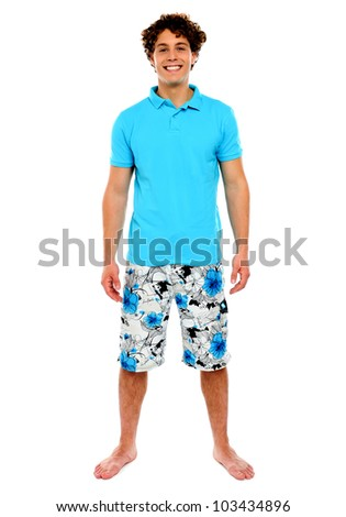 Man standing in shorts with smile on his face. Isolated - stock photo