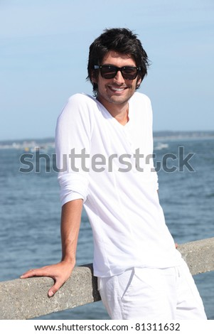 Man standing next to the ocean - stock photo