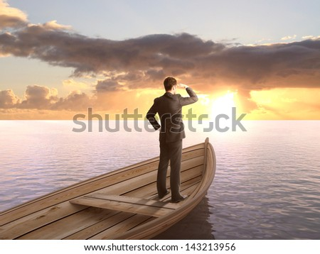 man standing on a boat and looking on sunrise