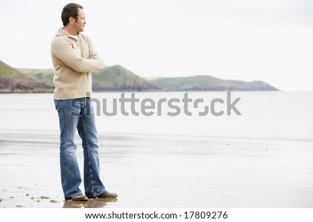 Man standing on beach - stock photo