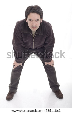 Man standing on his feet with hands on his knees - stock photo