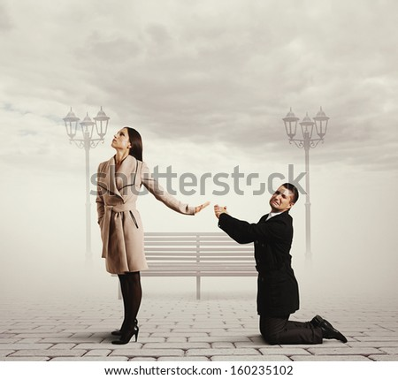 man standing on his knees and asking for forgiveness - stock photo