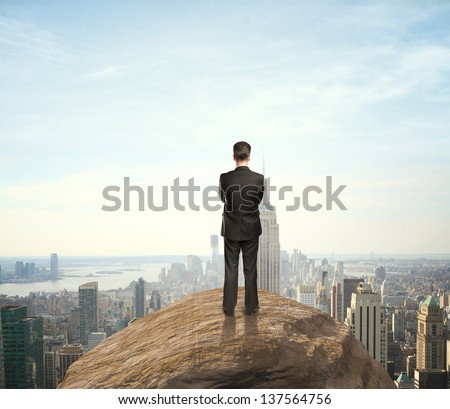 man standing on mountain - stock photo