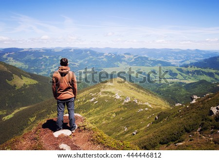 Man standing on the top of the mountain