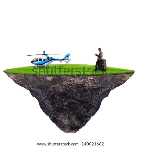 man standing with helicopter on green grass use for high class traveler - stock photo