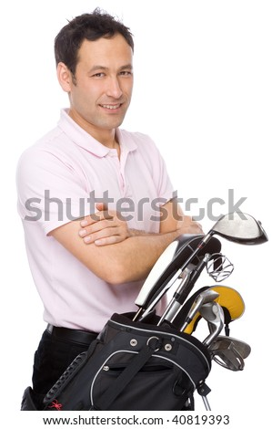 Man standing with his arms crossed near his golf kit - stock photo