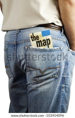Man standing with travel map in back pocket of denim blue jeans with copy space. - stock photo