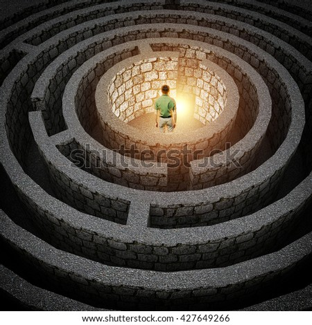 man stands in front of the exit of the labyrinth - stock photo