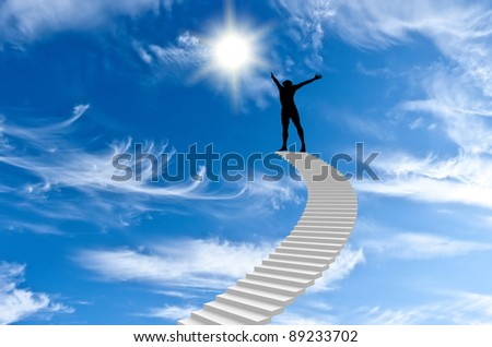 man stands on top of Stairs and extends to the sun - stock photo