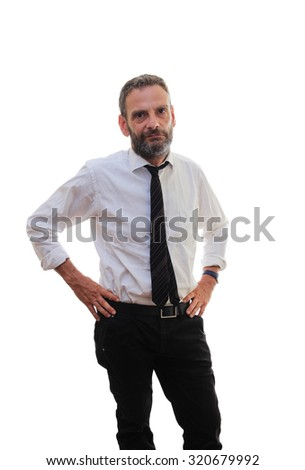 man stands with hands on his hips - stock photo