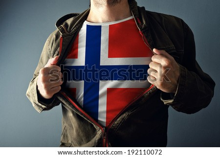 Man stretching jacket to reveal shirt with Norway flag printed. Concept of patriotism and national team supporting.