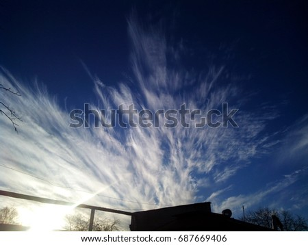 Man stride through deep on dramatic clouds background.