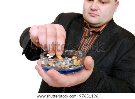 man stubs out his cigarette - stock photo