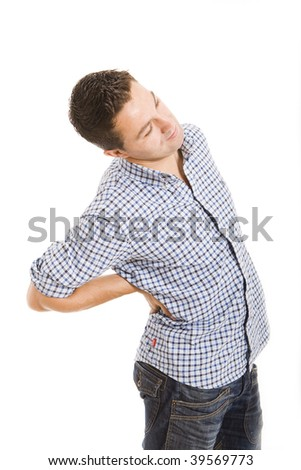 Man suffers from back pain - stock photo