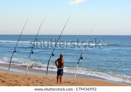 Man Surf Fishing on the east coast of Florida, USA. - stock photo