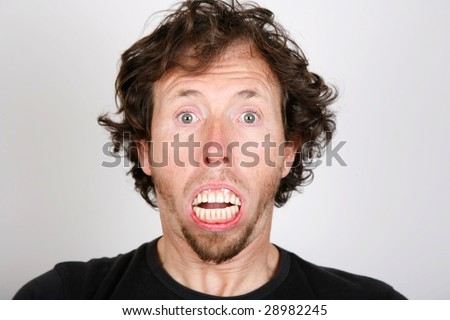 Man surprise with mouth full of teeth - stock photo