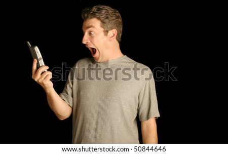 Man surprised on the phone - stock photo