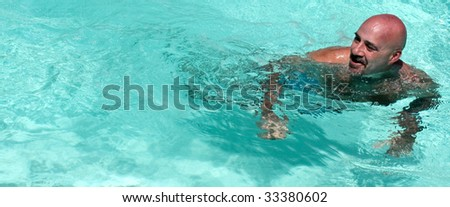 Man swimming in blue water.