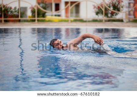 man swimming in pool - stock photo