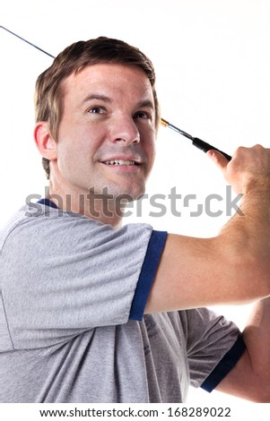Man swinging a golf club isolated on white.