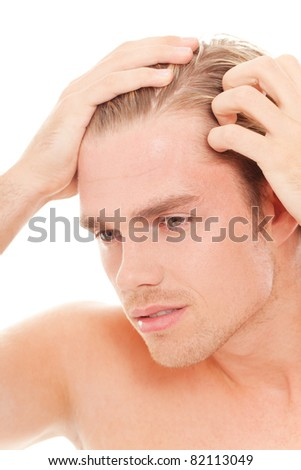 man take care of his hair - stock photo