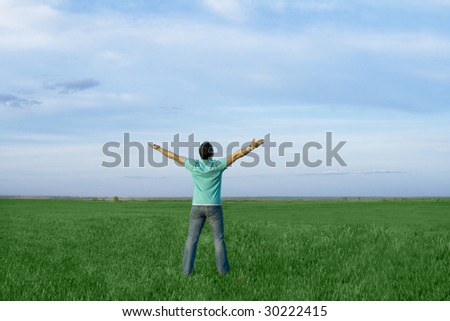 man take energy from nature in the meadow with dark blue sky