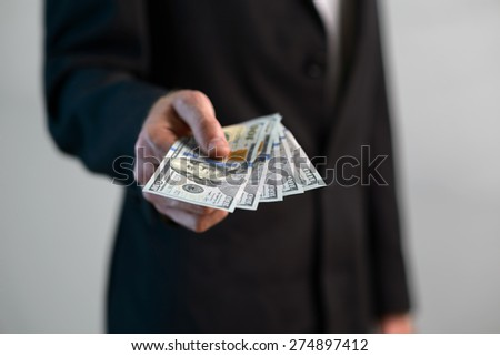 man takes a handful of money - stock photo