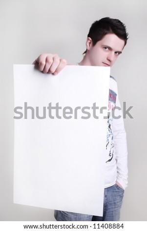 Man takes a placard at white background - stock photo