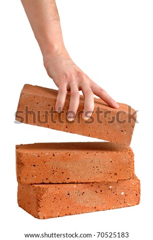 Man takes brick from the pile isolated on white background