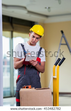 Man taking notes for delivery of boxes