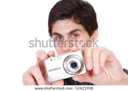 Man taking pictures photo camera in hands isolated on white background - stock photo